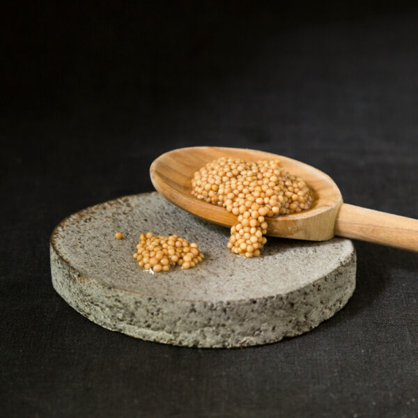 pickled mustard seed on spoon