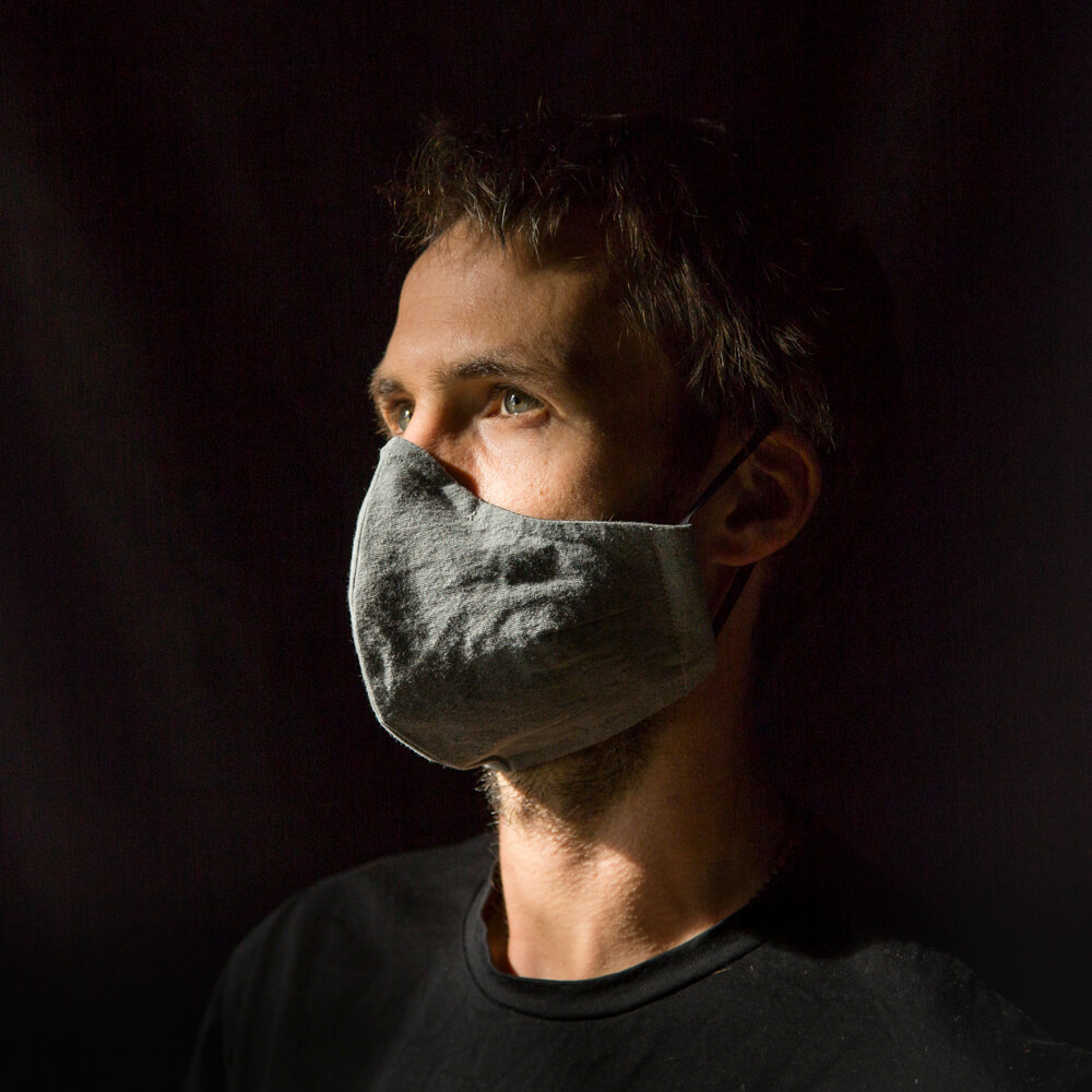 man with face mask light grey
