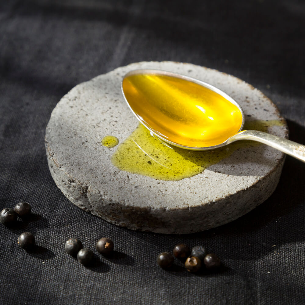 wild juniper oil on a spoon